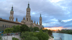 Time lapse on sunset, Catholic Basilica Pilar by River Ebro Stock Footage