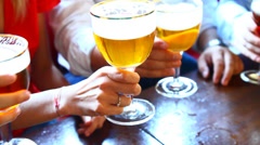 Four friends with a fresh beer Stock Footage