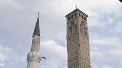 Old watch tower and minaret of Gazi Husrev mosque Stock Footage