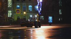 Snow-plough vehicle working at night street Stock Footage