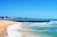 beach of tamariz in estoril, portugal - stock photo