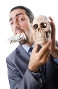 Antismoking concept with man and skull - stock photo