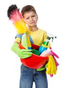 Sad boy with cleaning tools Stock Photos