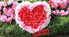 bouquet of flowers arranged in a heart shape. - stock photo