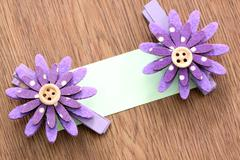 Hairpins of purple flower and note paper. Stock Photos