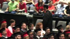 Male graduate returning to seat after receiving diploma. Stock Footage