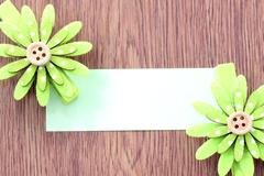 hairpins of green flower pattern and note paper. - stock photo