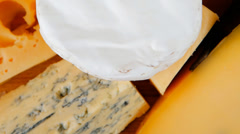 Cheeses on cutting board Stock Footage