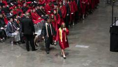 Fast speed of graduates walking from first row to stage Stock Footage