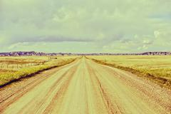 outback road - garvel country road in south dakota. horizontal photography. v - stock photo
