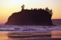 rocky island sunset - pacific northwest shore. nature photo collection. - stock photo