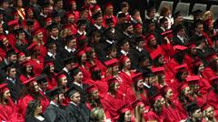 Graduates raising hands during ceremony. Stock Footage