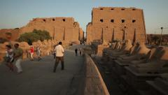 The temple of Karnak with people going in and out, Luxor, Egypt Stock Footage