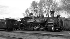 Vintage coal fired steam railroad in station BW HD Stock Footage