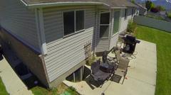 Neighborhood Street Aerial Lift Over Houses 1 Stock Footage
