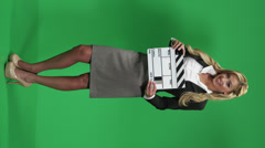 Female model holding a movie clapboard Stock Footage