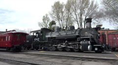 Vintage coal fired steam railroad in station HD 179 Stock Footage