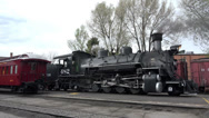 Stock Video Footage of Vintage coal fired steam railroad in station HD 179