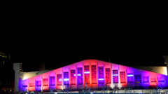 Wembley arena with animation exterior at night in london, uk Stock Footage