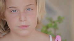 Child girl with serious face looking at camera (portrait) Stock Footage