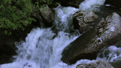 MountainsideWaterSurge-BreachingOverRocks Stock Footage