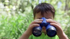 Little Boy Looks Through Binoculars At Camera Stock Footage
