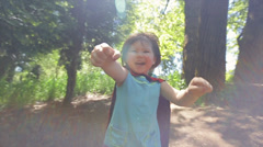 Closeup Of Little Girl With Fists Out, Pretending To Fly In Her Superhero Cape Stock Footage