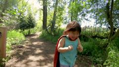 Little Asian Girl Pretends To Be Superhero, Run Towards Camera In Her Cape Stock Footage