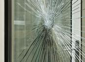 Stock Photo of smashed glass window pane