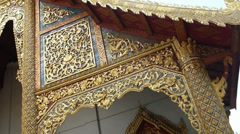 Stock Video Footage of Delicate roof of  Wat Phra Sing, a Buddhist temple in Chiang Mai, Thailand.