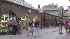 People passing by the Gazi Husrev-bey Library Stock Footage