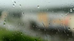 rain - water drops on the window(glass). Resharpening from the city at window - stock footage