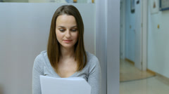 happy woman in the waiting room close up - stock footage