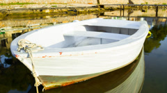 empty rowboat in porto colom (majorca - spain) - stock footage