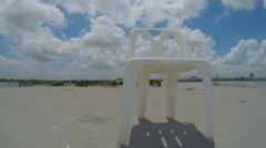 White plastic chairs on blue sky Stock Footage