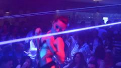 People dancing at a party (disco) - erotic woman dancing with stage lights Stock Footage
