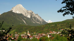 Typical village in the mountains of Germany with mountain and blue sky. Stock Footage