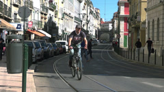 A traditional tram makes its way through a narrow street,Lisbon. Stock Footage