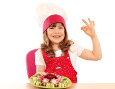 happy little girl cook with ok hand sign and decorated salad - stock photo