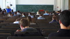 Students coming in University Auditorium classroom attenting for lecture Stock Footage