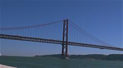 Suspension bridge Ponte 25 de Abril over the Tagus river in Lisbon, Portugal Stock Footage