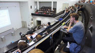 Stock Video Footage of Students coming in University Auditorium classroom attenting for lecture