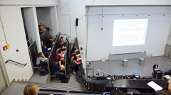 PAN Students coming in University Auditorium classroom attenting for lecture Stock Footage