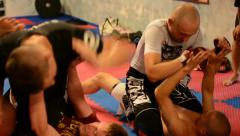 Men do sport - combat sports (fighting men) - in gym Stock Footage