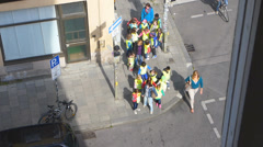 Group Kindergarten Kids Children guided by teacher crossing road Stock Footage