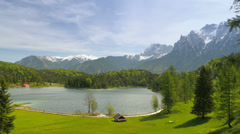 Picturesque lake in mountains of the alps. Stock Footage