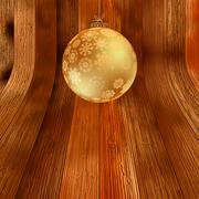 Gold bauble on rustic background.  + EPS8 Stock Illustration
