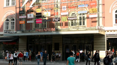 people in front of a shopping center on the urban street - stock footage