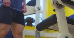 Pulling weight machine at gym Stock Footage