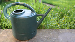 Water being pour badly into watering can Stock Footage